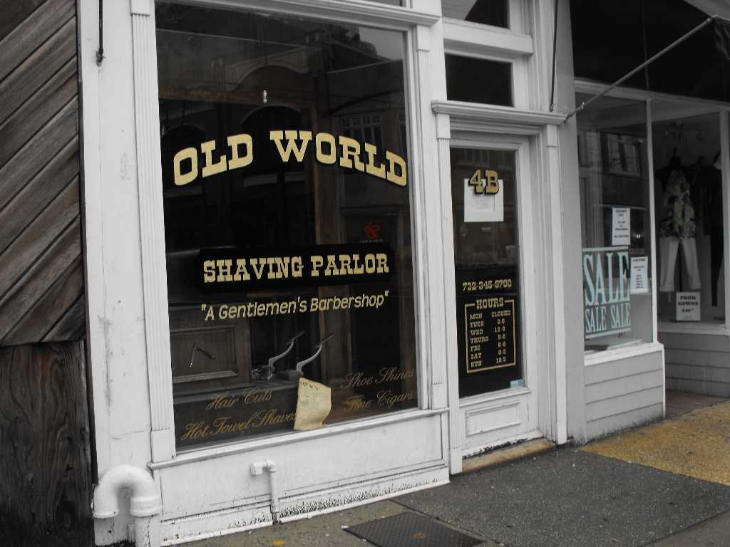 Old barber shop window - A Note On The Door Of The Old World Shaving Parlor Says It Is Closed For Renovation