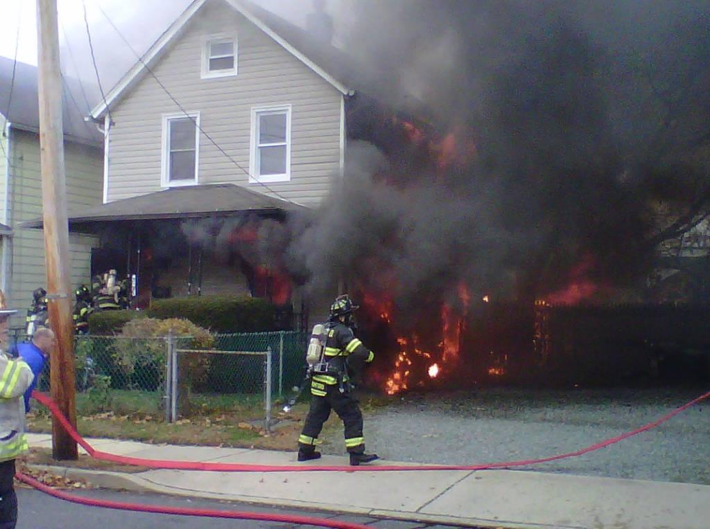 hot seat man escapes burning house red bank green. Black Bedroom Furniture Sets. Home Design Ideas