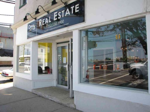 Sea bright putting a building back in biz red bank green for Toni fish realty