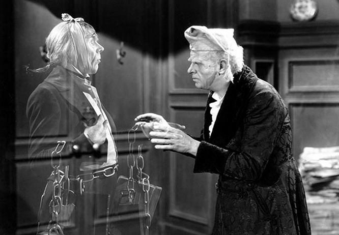 Reginald-Owen-right-with-Leo-G-Carroll-as-Marley's-Ghost-in-A-Christmas-Carol-1938